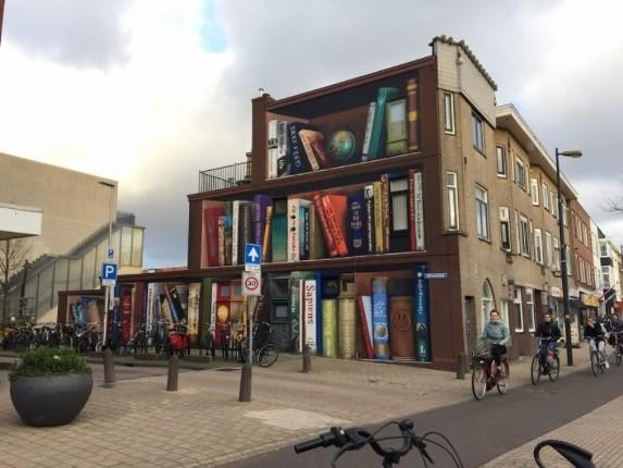 هنرمندان خیابانی هلند، ساختمانی معمولی را به قفسه کتاب تبدیل کردند